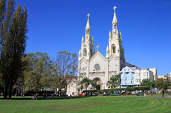 Sts. Peter and Paul Church in San Frascisco - USA. Sts. Peter and Paul Church in San Frascisco, USA, with pepople relaxing in the park USA Stock Images