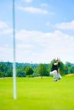 Sätta för golfspelare Arkivbild