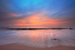 sätta på land solnedgången Arkivbilder