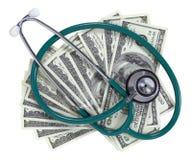 Stéthoscope et argent Images stock