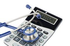 Stéthoscope et calculatrice Image libre de droits