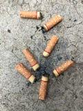 Stub сигареты на поле Стоковая Фотография