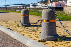 Stub posts linked in a chain on a quay Royalty Free Stock Photos