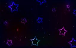Stubarwne gwiazdy na ciemnym tle Zdjęcia Royalty Free