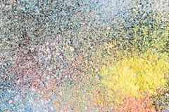 Stubarwne pył cząsteczki splattered na czarnym tle obrazy stock