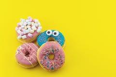 Stubarwni śmieszni donuts Obrazy Royalty Free