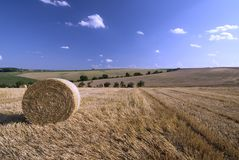 Stubble field with Hay Bale. Typical farmland with hay bale in Kraichgau, germany stock photos