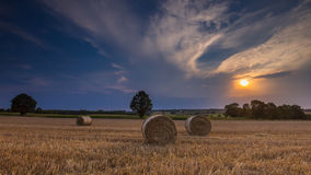 Stubble field with straw bales Stock Image