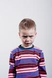 Stubborn boy. Stubborn,sad,upset little boy Stock Images