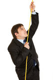 Stubborn businessman climbing up on rope Royalty Free Stock Images