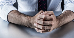 Stubborn businessman fists for fighting body language in corporate business. Stubborn businessman hands and fists held firmly showing restrained anger, stress or Royalty Free Stock Images