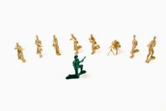 Stubborn Concept - Plastic Army Men. Isolated Plastic Toy Soldiers - Stubborn Concept Stock Photo
