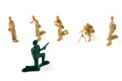 Stubborn Concept - Plastic Army Men. Isolated Plastic Toy Soldiers - Stubborn Concept Royalty Free Stock Images