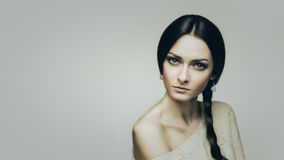 Stubborn. Fashion portrait of young brunette women on gray Stock Photography