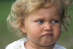 Stubborn look. Cute little two year old girl with a stubborn look on her face Royalty Free Stock Images