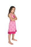 Stubborn looking girl standing with arms crossed. Cute girl, looking stubborn and standing with arms crossed Royalty Free Stock Images