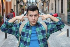 Stubborn pedestrian blocking his ears stock photos