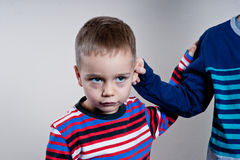 Stubborn,sad,upset little boy,child isolated. Over white background. Facial expression Royalty Free Stock Images