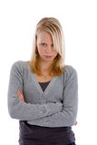 Stubborn teen. Pretty blond teenager with her arms crossed looking stubborn Royalty Free Stock Photo
