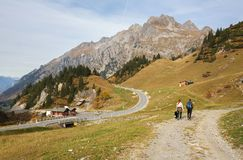 Couple of hikers on the alpine road near the village of Stuben am Arlberg. State of Vorarlberg, Austria, Europe. STUBEN, AUSTRIA - OCTOBER 18, 2018. Couple of stock photography