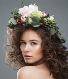 Stubio beauty portrait of cute young woman with flower crown Royalty Free Stock Photography