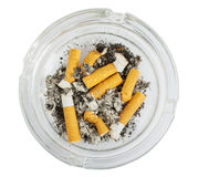 Stubs in glass ashtray top view Stock Photos