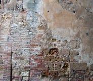 stuc le toscan de l'Italie cassé par brique Photos stock