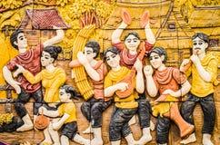 Stuc thaï de culture indigène sur le mur de temple Photographie stock