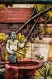 Stuc thaï de culture indigène sur le mur de temple Images libres de droits