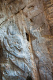 The stucco of ancient angle at the Khao Ngu Cave in Thailand Royalty Free Stock Images