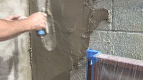 Stucco Application on Wall Royalty Free Stock Image