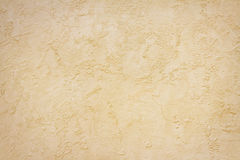 Stucco background. Textured beige surface, stucco background stock image