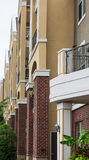Stucco Balconies Over Brick Columns Stock Photography