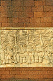 Stucco carved wall with laterite blocks wall Stock Image