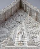 Stucco di Buddha sul timpano della chiesa Immagine Stock Libera da Diritti