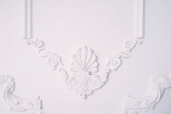 Stucco element of architectural decoration on the wall Royalty Free Stock Image