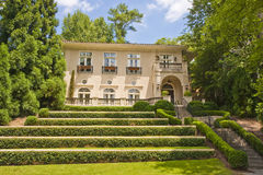 Stucco Home on Green Terraced Lawn Royalty Free Stock Image