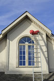 Stucco house window and extension ladder royalty free stock photos