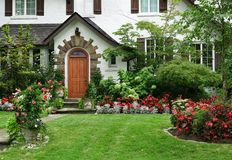 Stucco house with flowers in front yard