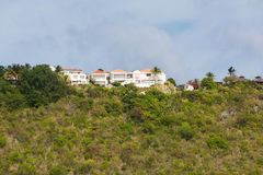 Stucco Mansion on Green Tropical Hill Royalty Free Stock Image