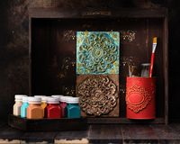 Stucco molding plaster decorative ceramic tiles, Paints and paint brushes on a wooden shelf. Set for drawing and creativity vector illustration