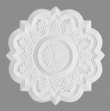 Stucco moulding rosette, isolated on grey. Floral stucco moulding rosette on grey background royalty free stock images
