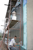 Stucco net. Plasterer inflicts mortar on stucco net Stock Photos