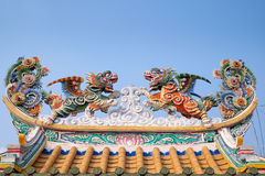 Stucco over roofing in chinese temple in Thailand Royalty Free Stock Photography