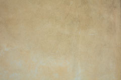 Stucco painted wall background. Close up of a stucco painted wall background royalty free stock images