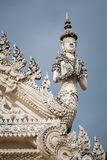 Stucco statue of guardian angel in salute posture Stock Photography