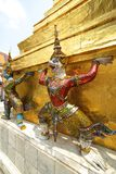 Unique figures of thai buddhist folk at chedi base Stock Photo