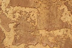Stucco Texture. Roughly mudded stucco wall texture in rich brown Royalty Free Stock Photos