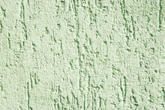 Stucco texture, rough ragged plaster background, scratched crack Royalty Free Stock Images
