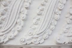 Stucco Thai style embossed  on the wall. Of the temple, Thailand Royalty Free Stock Image